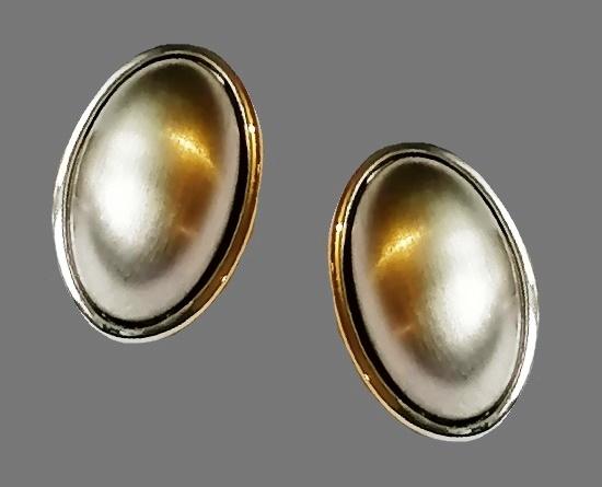 Oval shaped silver tone clip on earrings. 1990s