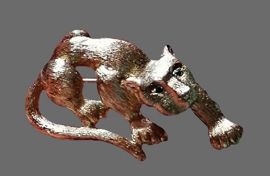 Panther gold tone textured metal brooch. 1980s