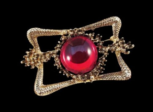 Red glass cabochon gold tone textured metal brooch. 1970s