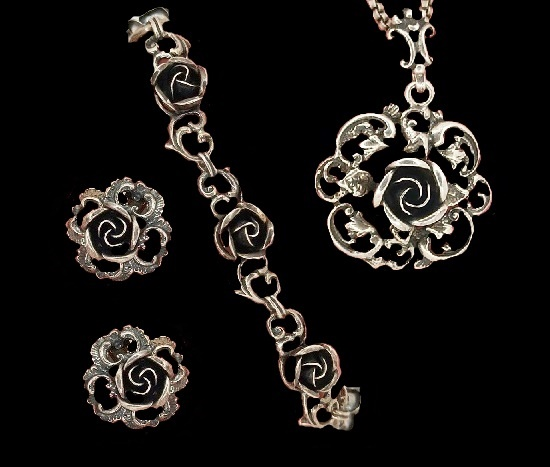 Rose design bracelet and clips. 925 sterling silver. 1950s