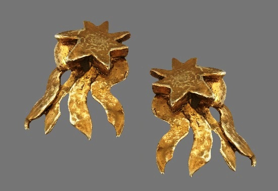 Shooting star gold tone clips. 1990