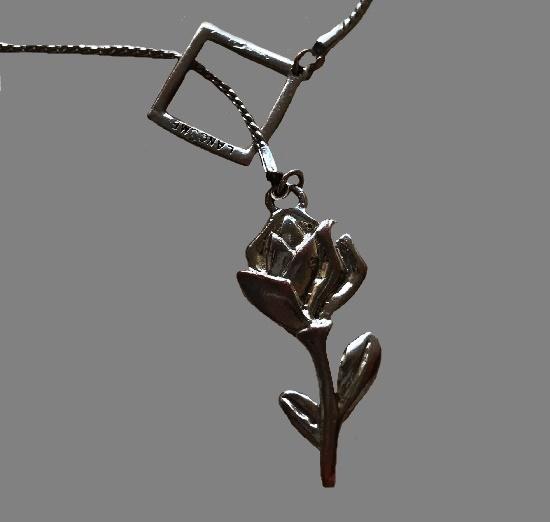 Silver tone rose pendant. 1980s