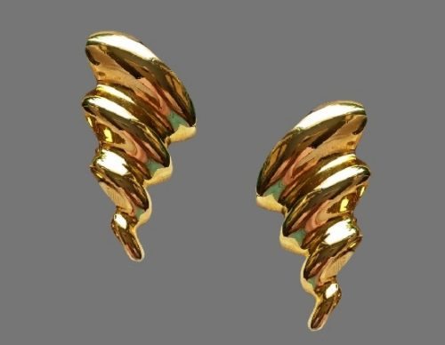 Spiral shaped vintage clips. Gold tone alloy. 4 cm. 1980s