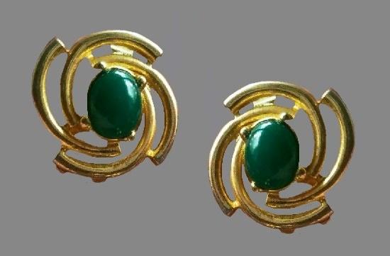 Swirl design green glass cabochon gold tone earrings. 1980s. PG for Pierre Cardin