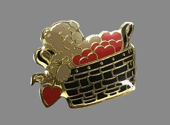 Toy bear with hearts in a basket lapel pin. Gold tone metal, enamel