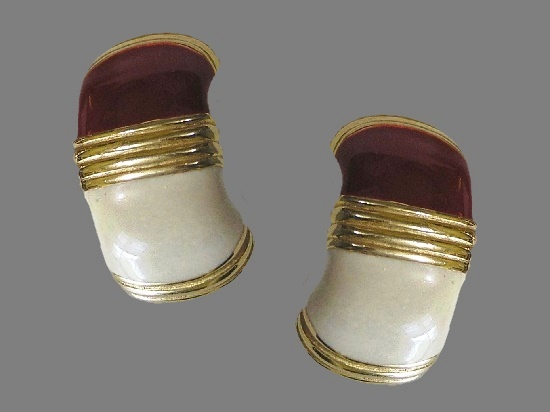 White and black enamel gold tone clip on earrings