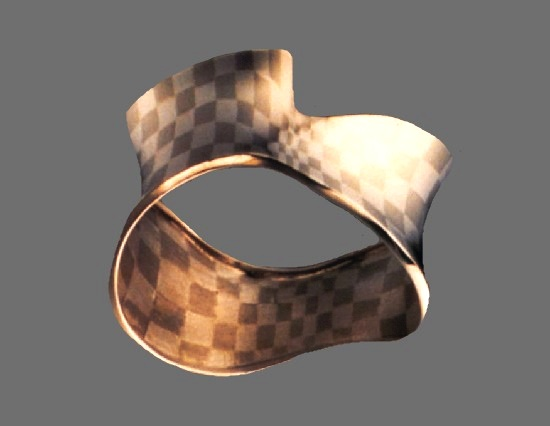 'Undulating Checks' varied-width cuff bracelet. Sterling silver, nickel silver. 1982