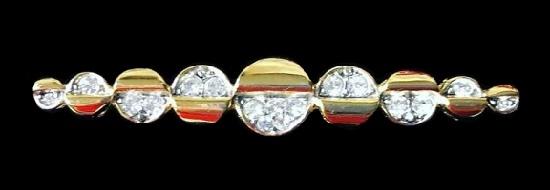 Bar brooch of gold tone, rhinestones. 6 cm. 1980s