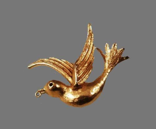 Bird brooch pendant of gold tone