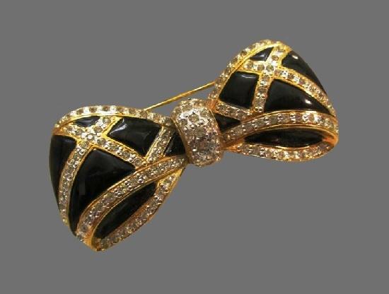 Black bow brooch. Gold tone alloy, pave rhinestones, enamel. 1980s