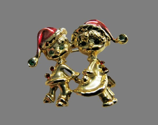 Boy and girl in Santa caps pin brooch. Gold tone alloy, enamel, rhinestones