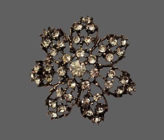 Crystal flower brooch. Silver tone metal, rhinestones