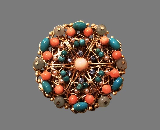 Filigree design beaded brooch. Gold tone metal, art glass, crystals