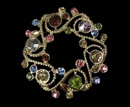 Filigree design wreath brooch. Gold tone, crystals, rhinestones