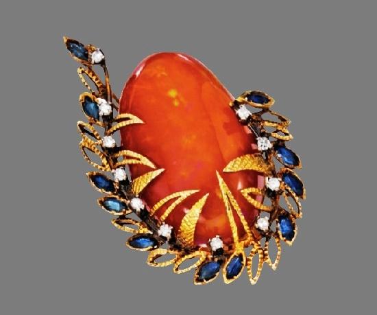 Fire opal ring. 18 Karat Gold, Fire Opal, Sapphire and Diamond. Mid 1980s