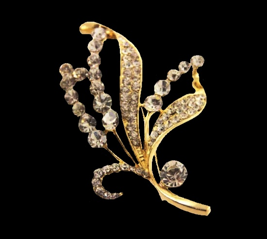 Floral spray vintage brooch. Gold tone metal, rhinestones