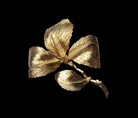 Four-leaf brooch. Gold plated textured metal. 1960s