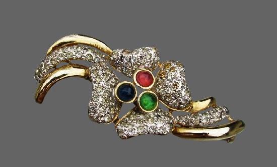 Four petal flower vintage brooch. Pave rhinestones, gold tone alloy, art glass. 1980s