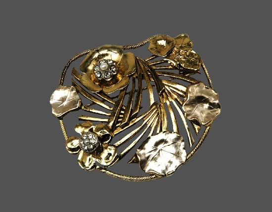 Gold tone floral design brooch. Brass, crystals, faux pearls
