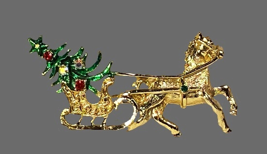 Horse carrying Christmas tree on sleigh brooch pin. Gold tone, enamel, rhinestones