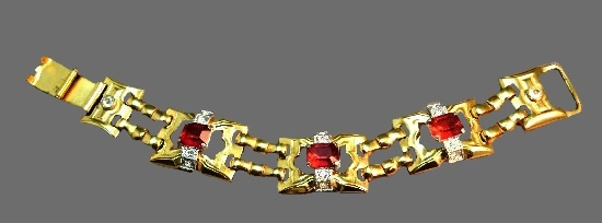Link bracelet of gold tone, red and clear rhinestones