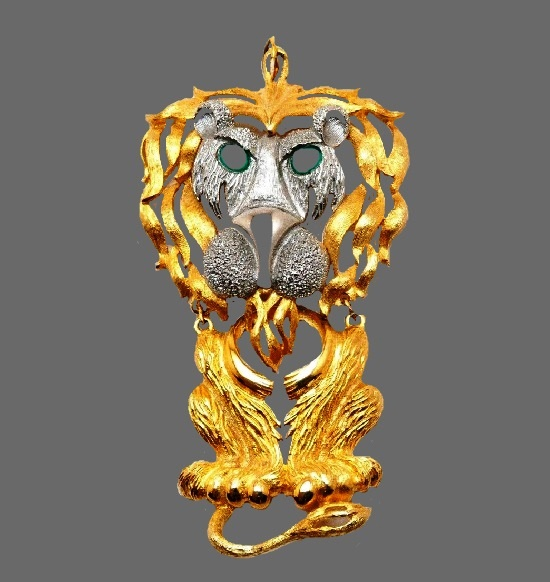 Lion pendant. Gold and silver tone