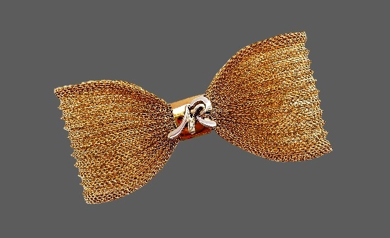 Mesh bow with NR initials brooch.