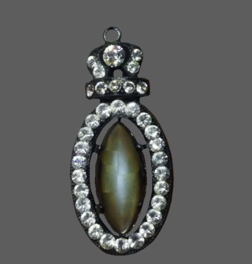 Oval and crown shaped pendant. Pave rhinestone, black finish, sterling silver, green cabochon
