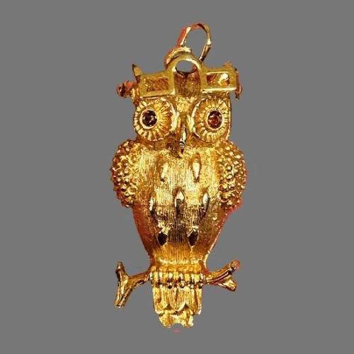 Owl with moving glasses brooch pin. Gold plated textured metal, rhinestones