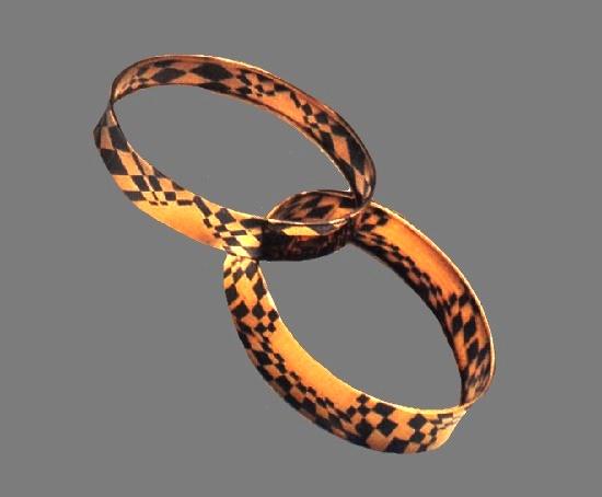 Patricia Daunis. Two cuff bracelets , one of 18k gold and copper, and one of 14k gold and copper. 1981-1982