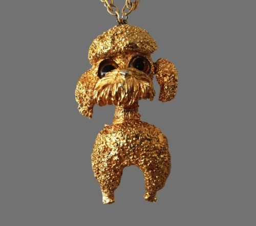 Poodle pendant. Gold plated textured metal, art glass
