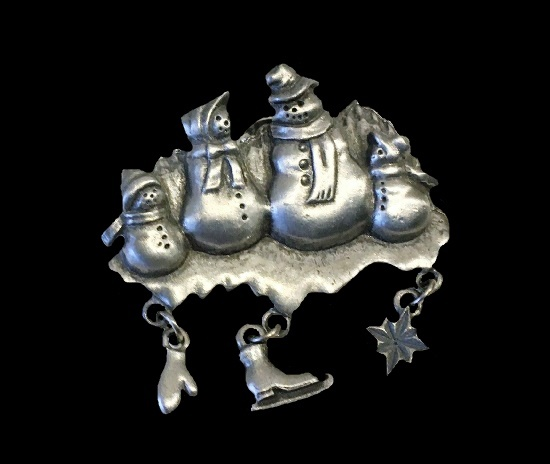 Snowmen family lapel pin with dangling mitten, skate and snowflake charms. Pewter