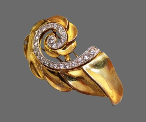 Swirl Nautilus design fur clip brooch. Gold tone metal alloy, rhinestones