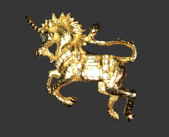 Unicorn brooch pin. Gold tone alloy, blue crystal