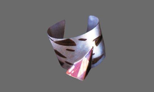 Wide open cuff bracelet. Sterling silver, brass, nickel silver, copper. 1982