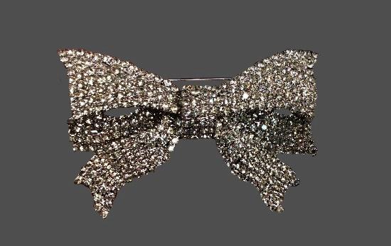 Bow brooch. Silver tone, clear rhinestones
