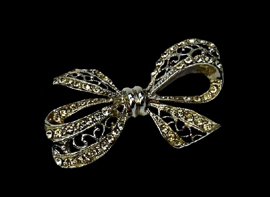 Bow ribbon filigree design brooch of blackened silver tone metal