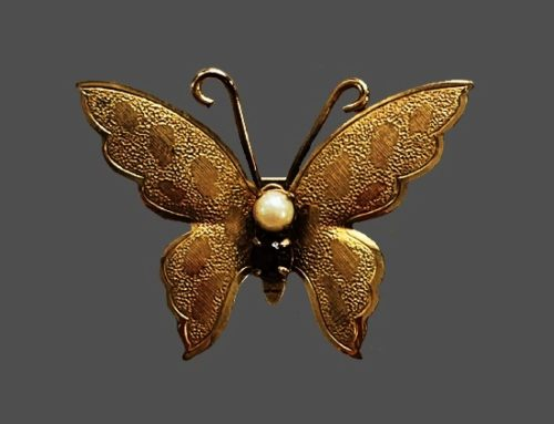 Butterfly brooch. 12 K gold filled textured metal, cultured pearl, glass cabochon