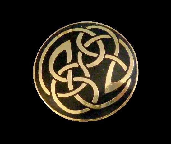 Celtic design pattern black enamel gold tone brooch. 1980s