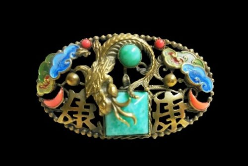 Chinese dragon oval shaped brooch. Brass, enamel, art glass, faux coral. 5.5 cm. 1940s