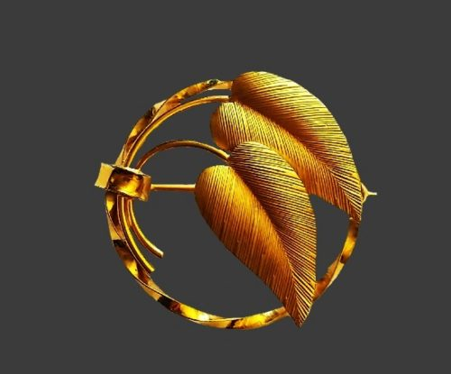 Classic round brooch with two leaves. 12 K gold filled textured metal base