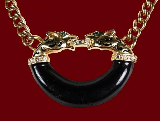 Cougar pendant. Gold tone metal alloy, rhinestones, plastic. 1980s