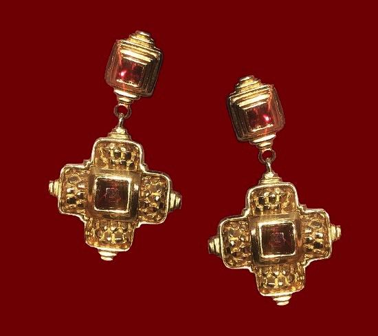 Cross dangling clip on earrings. Gold tone alloy, red rhinestones