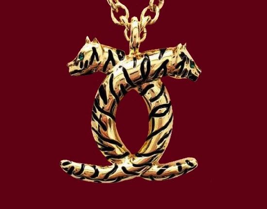 Double Leopard pendant. Gold tone metal alloy, enamel. 1990s