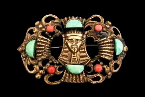 Egyptian motif brooch. Brass, glass. 6 cm. 1930s
