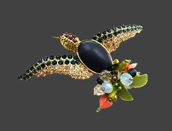 Flying bird brooch. Gold tone metal alloy, black onyx, rhinestones, beads, art glass