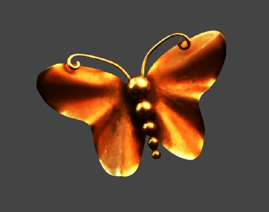 Gold butterfly brooch