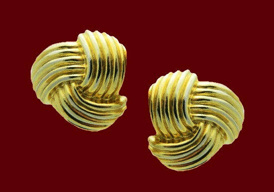 Knot shaped gold tone textured metal clip on earrings