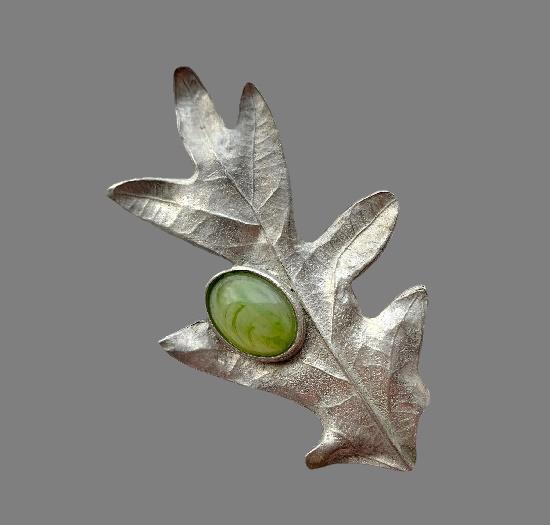 Oak leaf brooch. Silver tone textured metal, green cabochon. 9 cm. 1980s