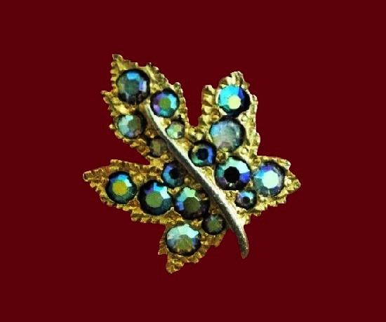 Rhinestone maple leaf gold tone brooch